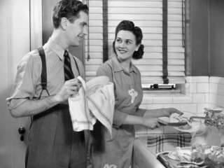 Man and Woman Washing Dishes Photographic Print by George Marks at