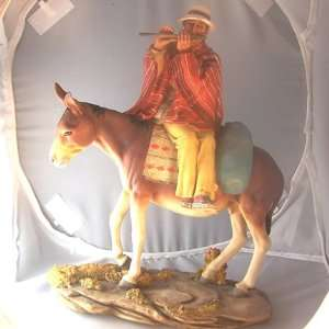 Inca Indian Man on Donkey Playing Flute Figurine
