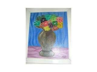 Cuadro titulado Jarrón con flores. Óleo sobre lienzo. Con marco de
