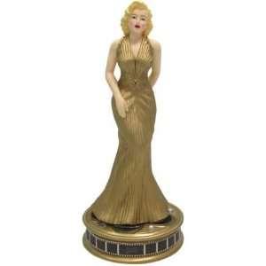 Marilyn Monroe Figurine in Glamorous Gold Dress on Film